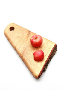 A piece of utility and novelty, the Wooden Cutting board is made of Oak and comes in a pizza slice shape.