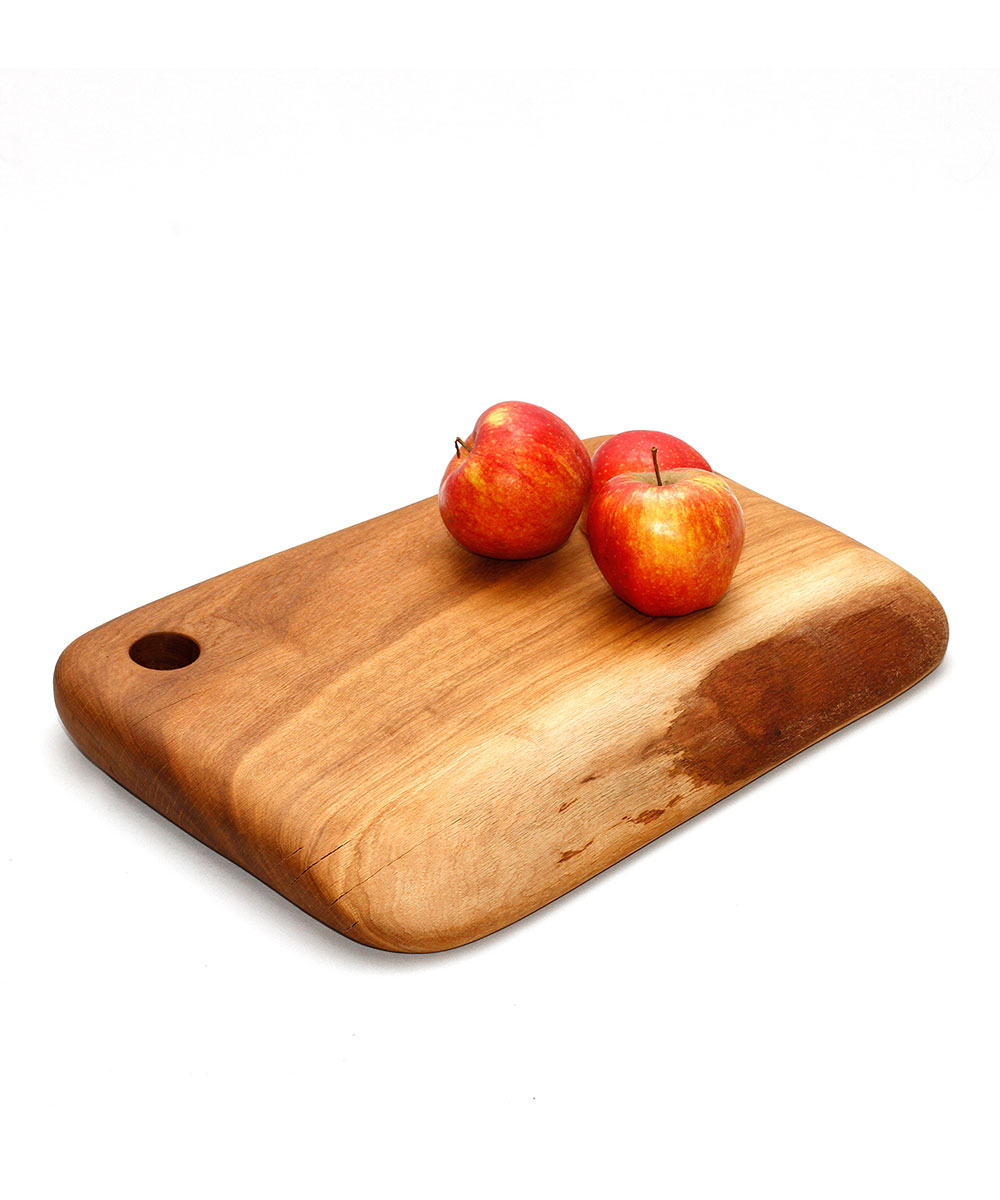 The wooden cutting board features a simple rectangular design